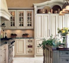 I like kitchens with a floor to ceiling wall of storage that resembles furniture. Pretty functionality!