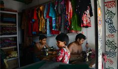 In a garment worker village in Ashulia, men work outside the factory setting, sewing traditional clothing.  Read more: http://www.post-gazette.com/gallery/Bangladesh-slideshow-by-Julia-Rendleman#ixzz3CKO3R6CE