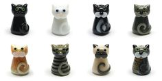 Lampwork glass cat beads by Laura Sparling. Available as loose beads, charms and necklaces.
