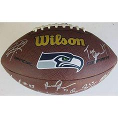 2013 Seattle Seahawks, Super Bowl Champs, Team, Signed, Autographed, Logo Footbal, a COA with the Proof Photos of the Seahawks Players Signing the Football Will Be Included