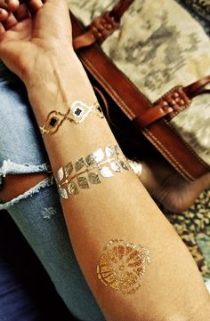 Adding a touch of metallic glam to every fall outfit with these gold and silver temporary tattoos. Tattoo Flash, Flash Tats, Gold Tattoo, Metal Tattoo, Me Time, Cartier Love Bracelet, Temporary Tattoo, Tatoos, Tatting