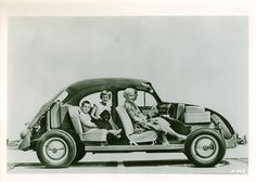 ►A cutaway view of the 1961 Volkswagen Beetle displayed the little car's packaging. Note how little space the engine uses; it's behind the rear axle.  2007 Publications International, Ltd