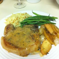 Pork chop with roasted apples and pearl onions and haricots verts with mustard vinaigrette and rice pilaf-Cooking Light recipe