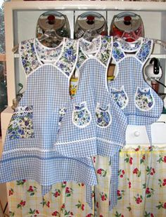1940 pansy blue gingham mother daughter aprons. Love the gingham floral combo. It would look fabulous in greens.