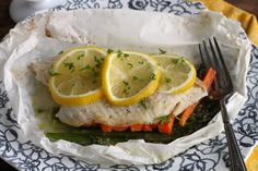How To: Fish Baked in Parchment  Serve as is, or with a bowl of steamed rice, quinoa, or couscous to soak up all the wonderful juices on the bottom.  A hunk of whole grain, crusty bread is quite fabulous as well.