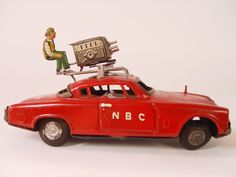 Studebaker NBC TELEVISION CAR ~ Rare Friction Car Made in Japan~ WITH CAMERA MAN!  Nice 7.75-inch long metal friction car with a camera man and camera on the roof. Good Condition for a car that was probably played with, a little rough but it'll still look great on the shelf.....All of the tin trim, parts and hubcaps have light to heavy tarnish, and even light rust in a few spots. The semi-flat interior is nicely lithographed.