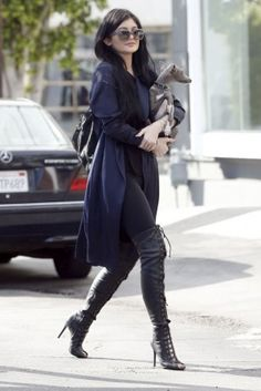 Kylie Jenner wearing Tom Ford Canvas Lace-Up Over-the-Knee Boots and Elizabeth and James Cynnie Sling Bag