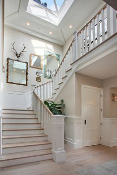 wide open staircase w/blonde flooring