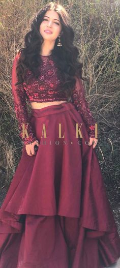 Featuring maroon double layer skirt in taffeta silk. Matched with crop top bloue with sheer full sleeve. Its embellishedi n resham and cut dana. Full Sleeve Crop Top, Crop Top Dress, The Dress, Fancy Dress, Indian Skirt And Top, Indian Crop Tops, Full Skirt And Top, Cropped Tops, Maroon Skirt Outfit