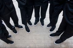 Grooms wearing Supra's with their tuxes!