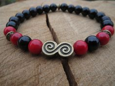 Check out this item in my Etsy shop https://www.etsy.com/listing/198900214/mens-onyx-bracelet-red-coral-bracelet