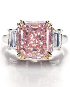 Rare pink diamond from Harry Winston, from Martha Stewart Weddings. We have the perfect dress (and another pink ring) to go with it. http://www.westchestermagazine.com/Westchester-Magazine/Westchester-Weddings/Annual-2012/Non-Traditional-Wedding-Gowns-Colorful-Wedding-Dresses-for-Westchester-County-Brides/