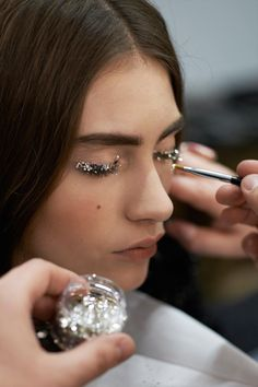 Marine Deleeuw backstage at Chanel Fall 2013 RTW at at Paris Fashion Week.