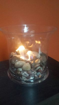 Diy mini portable fireplace.Tempered glass, polished stones, and a sterno can. Simple and beautiful!
