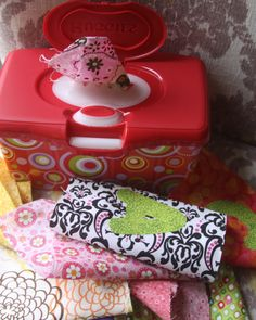Great idea!!! Fabric squares in a wipes dispenser. Hours of baby entertainment without the waste of wipes....