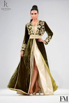Olive kaftan with white underskirt. Gold embroidery on the front and hem. Igen garb.
