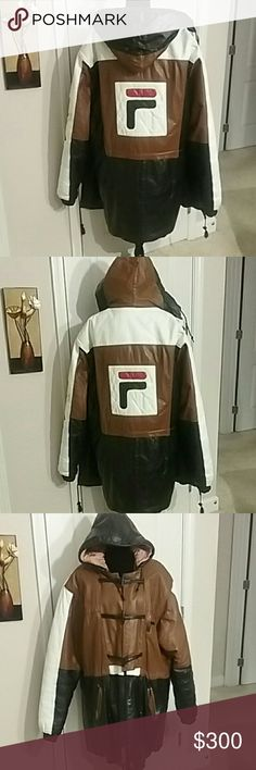 MEN'S  LEATHER FILA COAT Size Large  Fashionable  warm Beautiful men's leather coat  Gently used  Warm because of the lining in the inside  The inside lining is ripped and one pockets have a small rip  Please look at all pictures before purchasing this is a beautiful coat it can be fixed Once that's on you couldn't tell  Open to reasonable offers /OR  A MARK DOWN  Thank you once again for your business, interest in my closet, shares and likes. Ginger @canfield closet FILA Jackets & Coats