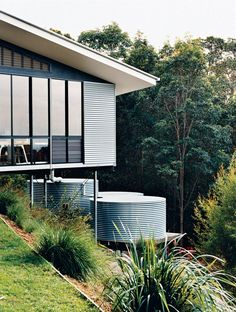 Hillside Family Home in Australia - Photo 7 of 12 - The studio is clad in corrugated tin, echoing the adjacent water-storage tanks, which collect and filter rainwater off the roof. Pole House, Water Catchment, Water From Air, Corrugated Tin, Water Storage Tanks, Rainwater Harvesting, Rain Barrel, Water Conservation, Decoration