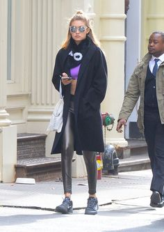Pin for Later: Proof That Gigi Hadid Is Having a Love Affair With Athleisure Making Gymwear Look Runway-Ready The liquid leggings and all-black Nikes are a nice touch.