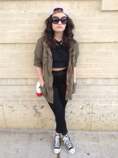Black high-waisted jeans, crop top, army jacket, cap