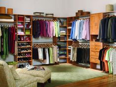 Spacious Serenity!The distinctive characteristic of this master closet is the open floor plan. An area rug and dressing chair create an inviting feel. For closet systems that don't extend to the ceiling, add decorative boxes that double as storage. Photo: ClosetMaid