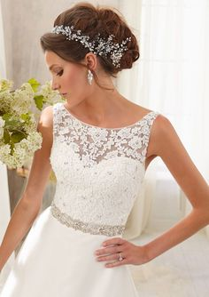 I'm in love with this dress! I prefer wedding dresses with straps