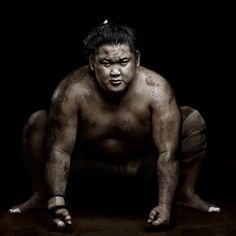 2013, Sports Feature, 2nd prize stories, Denis Rouvre. SUMO WRESTLERS (22 February 2012).   Tokyo, Japan : Kenji Daido.   The life-long discipline, harsh physical training, and preparation for the fight can explain the half-god status of Sumo in Japan today. Part of a team, the wrestlers are required to follow a strongly codified community life; the youngest execute tasks for the community and even serve the oldest.