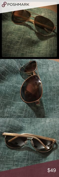Authentic Ralph Lauren Aviator sunglasses. Few scratches but in really good condition. Great addition to any outfit! Polarized. Ralph Lauren Accessories Sunglasses