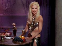 """Drusilla was the personal slave of Proconsul Claudius Marcus on planet 892-IV in 2268. Extremely attractive, she was described by Claudius as """"a lovely thing."""" (TOS: """"Bread and Circuses"""")"""