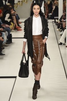 See the complete Tod's Fall 2017 Ready-to-Wear collection. Brown long leather skirt with ankle boots and socks runway fashion