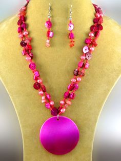Fuchsia necklace set with fuchsia stones and large fuchsia circle pendant with matching earrings. Lead Compliant. $16.95 shipped! We accept PayPal!