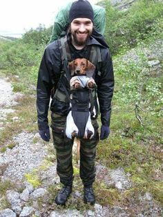 A hot guy carrying a dachshund in a baby carrier. What more do you need for the ideal hiking trip? #Dachshund