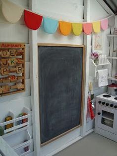 I like the idea of decorating inside with a Chalkboard (which I have) and some bunting (which I also have). I also like white inside. Since some of the frame is metal, we can consider some magnets?