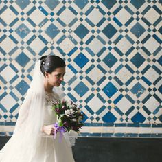 A classic Portugal wedding with adorable table numbers... loving the tile work at the church's entrance!