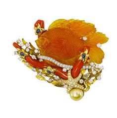 A carved fire opal, diamond, coral and sapphire brooch, Valentin Magro #FireOpal #opal #fish #carving