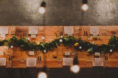 Community wooden farm table seating arrangement Lemon fern vine decoration Modern Stylish Jersey City Winter Wedding Modern Stylish Jersey City Winter Wedding  Parlay Studios New Jersey NJ Indie Hip Non Traditional Wedding Photographer Brooklyn NYC New York Chellise Michael Photography Top Wedding Photographer