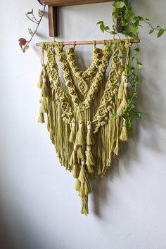 This simple macrame wall hanging in 'green tea' will be a perfect fit in your eclectic, bohemian space! #macramewallhanging #eclecticbohemiandecor #greenbohobedroom #greenboholivingroom #wallhangings Yarn Wall Art, Big Wall Art, Boho Bedroom Decor, Bohemian Decor, Modern Crafts, Diy And Crafts, Big Canvas Prints, Contemporary Metal Wall Art, Boho Green
