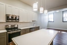 A wonderful restoration of an important urban building in Patterson Park, MD.   Kitchen Cabinets and Bathroom Cabinets provided by KBC Direct- Maryland's Kitchen Cabinet Expert.