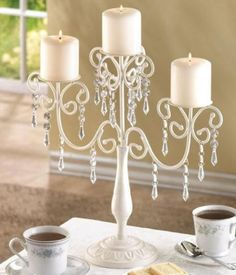 Change in plans how about these kind (can paint if you want black) for centerpieces??@Sarah Duenas   @Zoyla Duenas