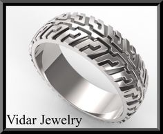 Tire Tread Mens Wedding Band In 925 Sterling Silver  Welcome to Vidar Jewelry by Roi Avidar! Specializing in custom Diamond & Gemstone, engagement rings & wedding rings sets.   If your man wants to make statement then this Tire Tread Mens Wedding Band is for him!    details:  SKU: Wedd104  metal/weight/detail: 925 sterling silver 6gr  width: 7mm  thick: 1.5mm $550