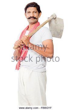 1 indian rural farmer man Standing Holding Spade - Stock Image