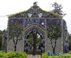 15 DIY Ways How to Reuse Glass Bottles, Buddhist temple build from glass bottles  YOU COULD MAKE A HOME OUT OF THESE, TOO
