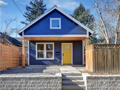 This detached ADU in the Woodlawn neighborhood is one of Portland's most popular Airbnbs. It boasts modern finishes and soaring ceilings. Small Cottage Designs, Small House Design, Small Cottages, Small Houses, Foreclosed Properties, Modern Bungalow House, Three Bedroom House, Small Modern Home, Exterior Paint Colors