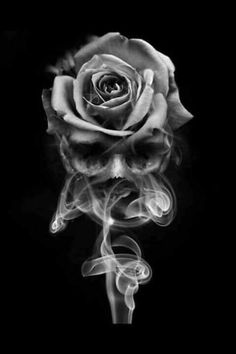 love the how the smoke skull and rose come together