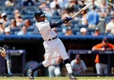 Alfonso Soriano #12 of the New York Yankees follows through on a 4th inning home run against the Detroit Tigers at Yankee Stadium on August 11, 2013 in the Bronx borough of New York City. The blast was the 2,000th major league hit for Soriano. (Photo by Jim McIsaac/Getty Images)