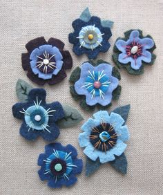 Felted wool flowers in blue. Appliques, brooches, or hairpins--haven't decided yet! Felted Wool, Wool Felt, Felt Crafts, Zippers, Appliques, Hair Pins, Brooches, Handmade Items, Patterns