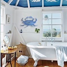 Bringing in the beach cottage atmosphere by using a bold sea life decoration (Blue Crab)