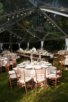 backyard wedding. long table for wedding party, round tables for better conversation for   everyone else