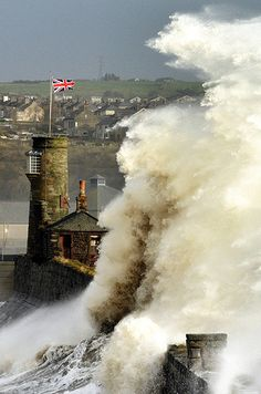 Huge waves engulf Whitehaven harbour in Cumbria on Thursday morning as gale-force winds cause havoc throughout the country
