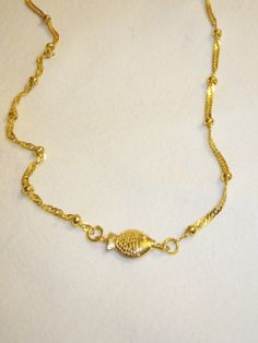 A personal favorite from my Etsy shop https://www.etsy.com/listing/179096637/gold-platedfish-charm-necklacegold